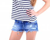 Beautiful young girl in shorts and t-shirt, close-up, isolated on white