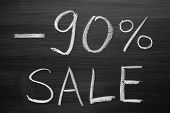 90-percent sale title written with a chalk on the blackboard
