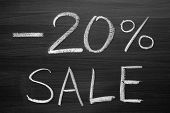 20-percent sale title written with a chalk on the blackboard