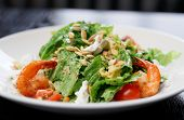 Caesar salad with prawns and goat cheese