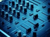 stock photo of controller  - Closeup of dj controller with selective focus - JPG