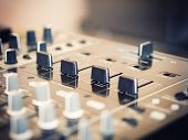Closeup of dj controller with selective focus