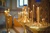 pic of church interior  - Burning candles in a Russian ortodox church - JPG