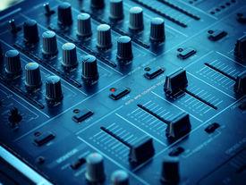 image of controller  - Closeup of dj controller with selective focus - JPG