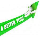 A Better You 3d words on a green arrow and a man riding it upward to illustrate self improvement or help to achieve and succeed in job, career or life