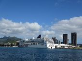 Ncl Cruiseship, Pride Of America,  Docked In Honolulu Harbor With City And Mountains In The Distance