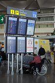 Flight information boards at Malaga airport.