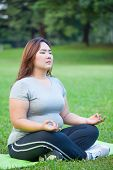 Plus Size Woman Practicing Yoga