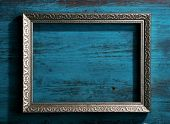 stock photo of  photo  - Vintage photo frame on color wooden background - JPG