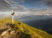 Summit cross on the mountain peak