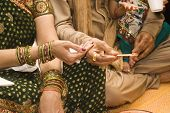 image of indian wedding  - mother and father doing indian tradition before their son - JPG
