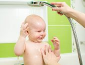 Cute child taking a bath