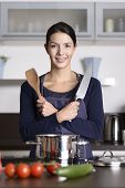 Smiling Happy Housewife Preparing Dinner