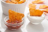 Tortilla Chips Dipped In Sauce