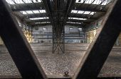 Looking Through Steel Girders In Abandoned Hall