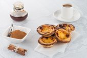 foto of pasteis  - Closeup of delicious traditional asian dessert egg tarts - JPG