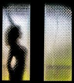 Silhouette Of Woman Stretching Herself