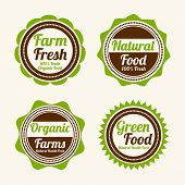 Set of four badges of farm fresh, natural food, organic farms and green food shop on beige  background.