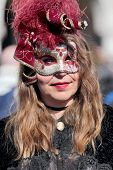 Masked Woman In Venice During The Carnival