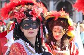 Two Red Masked Women At Carnival Of Venice