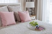 Pink Pillows On Bed With White Tray Of Flower