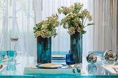 Vase Of Flower On Glass Dinning Table