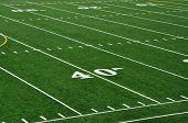 stock photo of bleachers  - Forty Yard Line on American Football Field - JPG