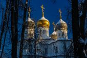 Orthodox Church With Gilded Domes And Crosses