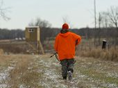 picture of hunter  - A deer Hunter walking to his blind - JPG