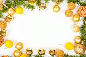 New Year Decoration With Pine Or Fir And Many Yellow Ornaments Balls
