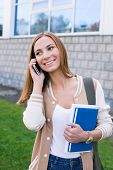 Student Talking On Phone And Looking Away