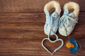stock photo of pacifier  - The heart symbol is drawn laces of children - JPG