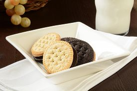 foto of duplex  - Chocolate and vanilla duplex sandwith cookies with milk - JPG