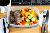 stock photo of lunch box  - homemade lunch box at modern stylish work place - JPG