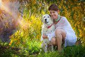 foto of mongrel dog  - family pet mongrel dog outdoors with female owner - JPG