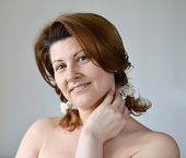 picture of bare-naked  - Portrait of an adult woman with a bare shoulders - JPG