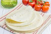 stock photo of whole-wheat  - Whole wheat flour tortillas with tomatoes and olive oil on the background - JPG
