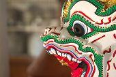 stock photo of hanuman  - Closeup of side view part of Hanuman head figure - JPG