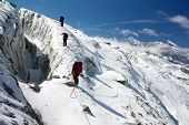 picture of mountain-climber  - group of climbers on rope on glacier  - JPG