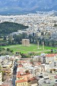 image of olympian  - A view across the rooftops of Athens to the temple of Olympian Zeus - JPG