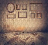stock photo of dirty  - old grunge interior with empty vintage frames and watch against an dirty wall - JPG
