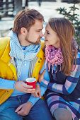 foto of sweethearts  - Happy young sweethearts flirting outdoors - JPG