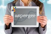 pic of aspergers  - The word asperger and businesswoman showing a tablet pc against blue medical background with dna and ecg - JPG