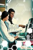 stock photo of scientist  - Science and medical graphic against portrait of focused scientist comparing results - JPG