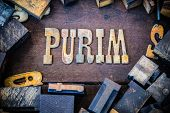 foto of purim  - The word PURIM written in rusted metal letters surrounded by vintage wooden and metal letterpress type - JPG
