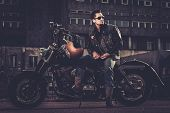 foto of carburetor  - Biker and his bobber style motorcycle on a city streets  - JPG