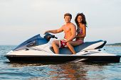 picture of ski boat  - Multinational couple sitting on a jet ski - JPG