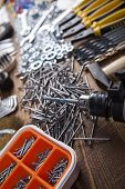 image of triplets  - Working tools on wooden background - JPG