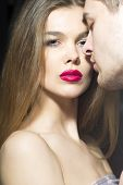 stock photo of sexuality  - Tender sexual couple of lover standing close to each other vertical picture - JPG