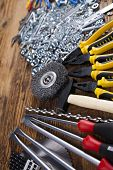 stock photo of triplets  - Working tools on wooden background - JPG